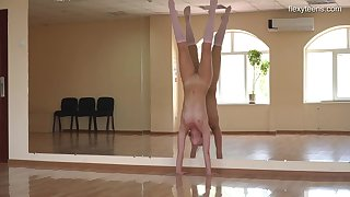 Ballerina strips and shows off the brush flexible body